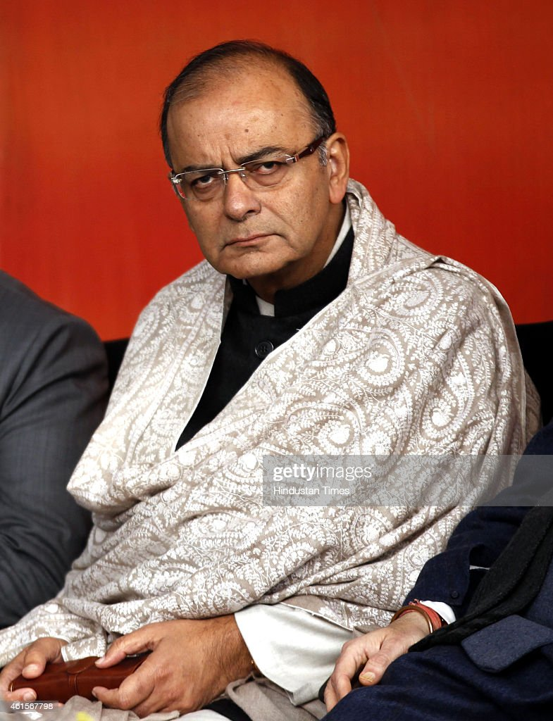 Union Finance Minister <a gi-track='captionPersonalityLinkClicked' href=/galleries/search?phrase=Arun+Jaitley&family=editorial&specificpeople=2660950 ng-click='$event.stopPropagation()'>Arun Jaitley</a> during a press conference after former IPS Kiran Bedi joined the BJP at party headquarters on January 15, 2015 in New Delhi, India. Bedi, who was earlier attached with India Against Corruption led by Anna Hazare, became a member of the BJP party by dialling the toll-free number started for the BJP's mass membership drive. Polling in Delhi will be held on February 7 and the counting of votes will take place on February 10.