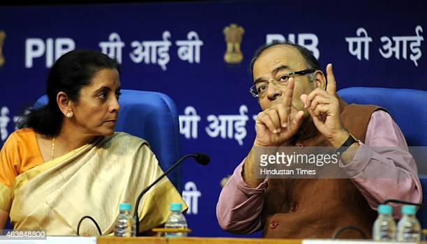 Union Finance Minister Arun Jaitley talking with Minister of State for Commerce and Industry Nirmala Sitharaman at the launch of Central Services on...