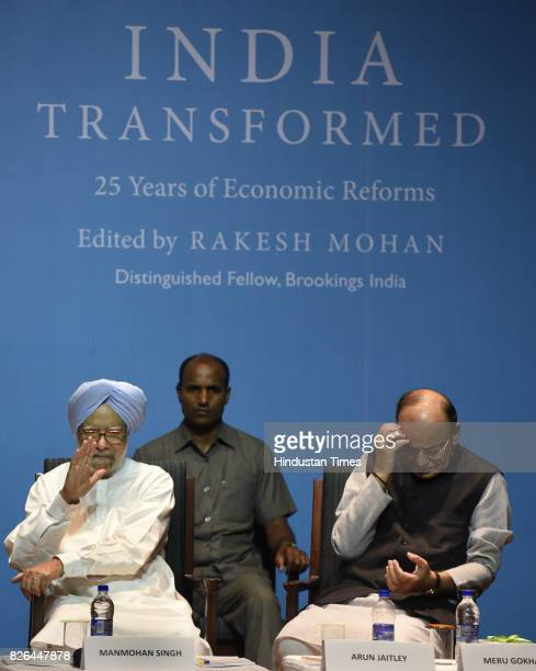 Union Finance Minister Arun Jaitley with Former Prime Minister Dr Manmohan Singh during the launch of a Book India Transformed 25 years Economic...