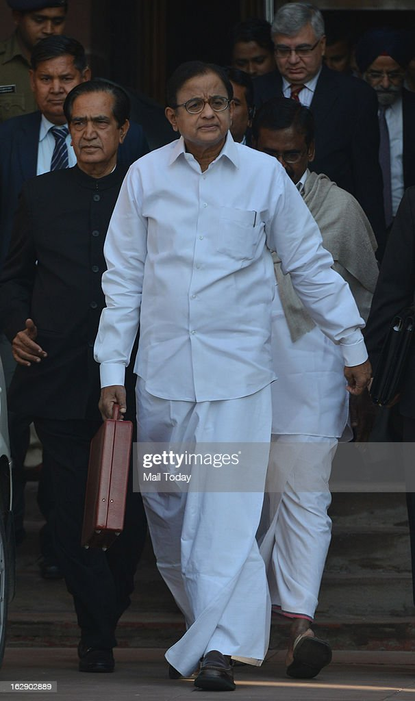 Union Finance Minister P Chidambaram leaving his office to present the Annual Budget 2013 - 14 in Parliament House, in New Delhi on Thursday.