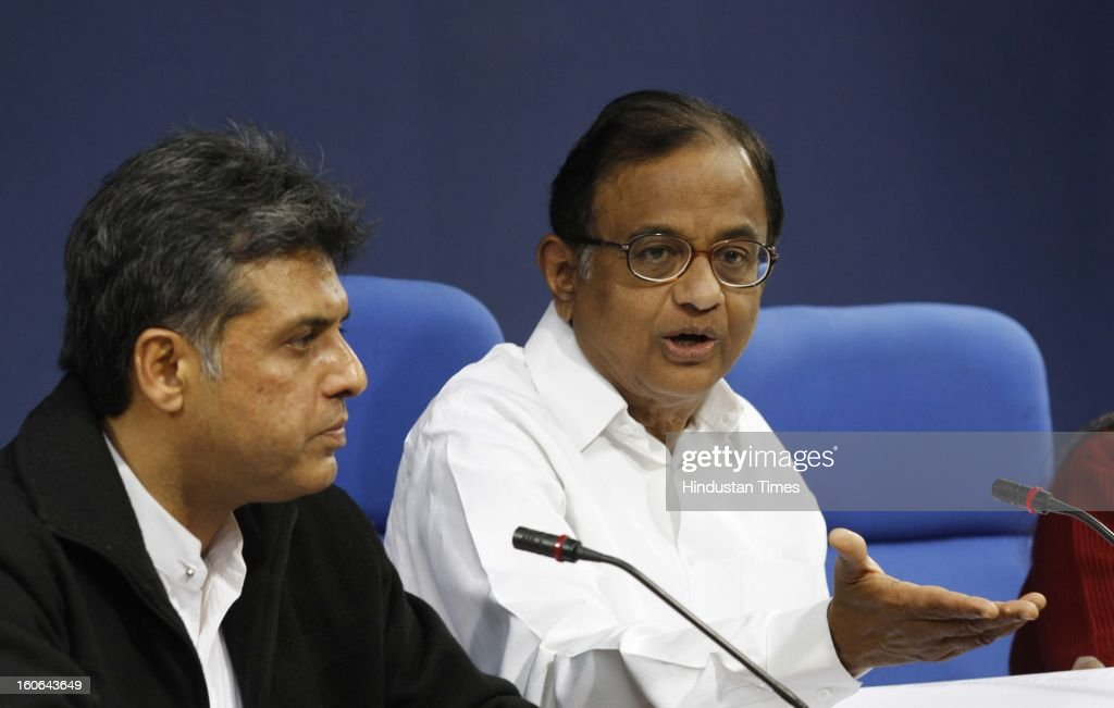 Union Finance Minister P. Chidambaram with Manish Tewari Union minister of State for Information and Broadcasting at press Conference on February 4, 2013 in New Delhi, India. Chidambram today said that the ordinance on sexual violence against women was promulgated to meet the 'universal demand' for a law and expressed hope that stringent provisions in ordinance will have deterrent effect on potential criminals till a new law is enacted by Parliament.
