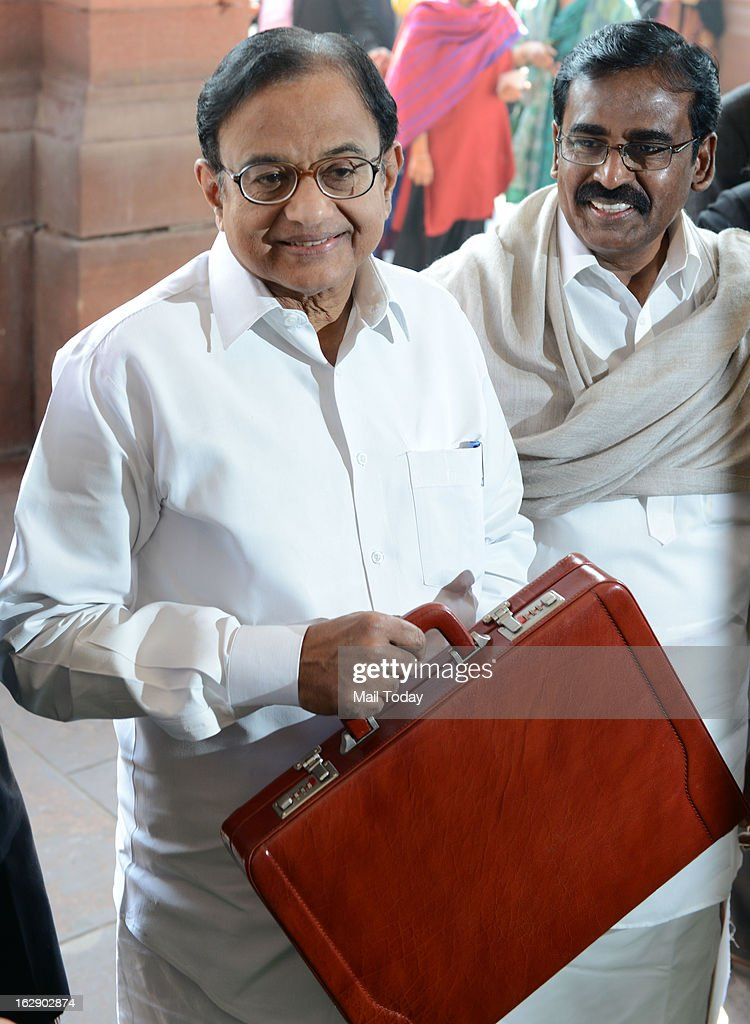 Union Finance Minister P. Chidambaram with Ministers of State for Finance SS Palanimanickam arrive in Parliament House to present the Annual Budget 2013-14, in New Delhi on Thursday