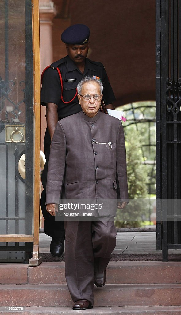 Union Finance Minister <a gi-track='captionPersonalityLinkClicked' href=/galleries/search?phrase=Pranab+Mukherjee&family=editorial&specificpeople=565924 ng-click='$event.stopPropagation()'>Pranab Mukherjee</a> departs after a meeting of Cabinet ministers called for by the Prime Minister's office on June 14, 2012 in New Delhi, India. Senior party leaders held meetings in the wake of Trinamool Congress's and Samajwadi Party's proposal of a Presidential candidate.