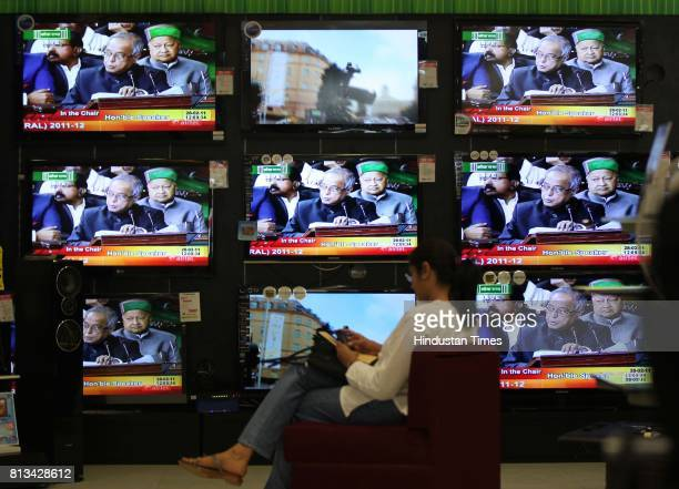 Union Finance Minister Pranab Mukherjee presenting the annual Budget 201112 is seen on a TV Screen at the shop at prabhadevi on Monday