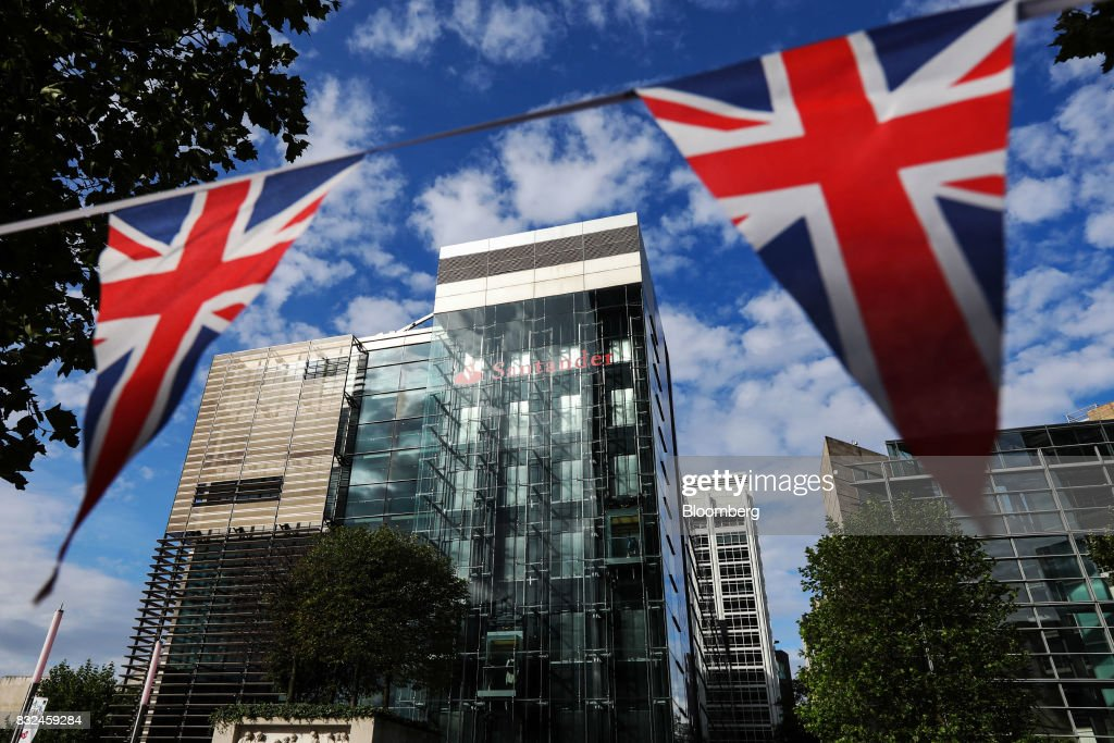 Union flag, also known as the Union Jack, bunting flies outside the offices of Banco Santander SA in London, U.K., on Tuesday, Aug. 15, 2017. Banco Santander, Spains biggest lender, has bought minority stakes in three financial-technology firms as ChairmanAna Botinmakes machine learning a hallmark of her growth plan. Photographer: Luke MacGregor/Bloomberg via Getty Images