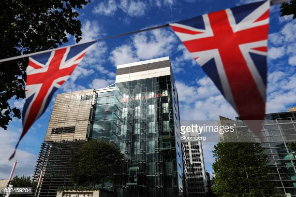 Union flag also known as the Union Jack bunting flies outside the offices of Banco Santander SA in London UK on Tuesday Aug 15 2017 Banco Santander...