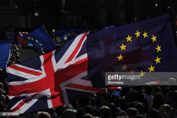 A Union flag also known as Union Jack left and a European Union flag fly as protesters march during a Unite for Europe march to protest Brexit in...