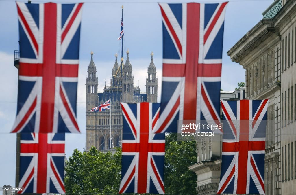 Union flag banners hang across a street near the Houses of Parliament in central London on June 25, 2016, after the announcement that the UK had voted on June 23 to leave the European Union in a national referendum. The result of Britain's June 23 referendum vote to leave the European Union (EU) has pitted parents against children, cities against rural areas, north against south and university graduates against those with fewer qualifications. London, Scotland and Northern Ireland voted to remain in the EU but Wales and large swathes of England, particularly former industrial hubs in the north with many disaffected workers, backed a Brexit. / AFP / Odd ANDERSEN