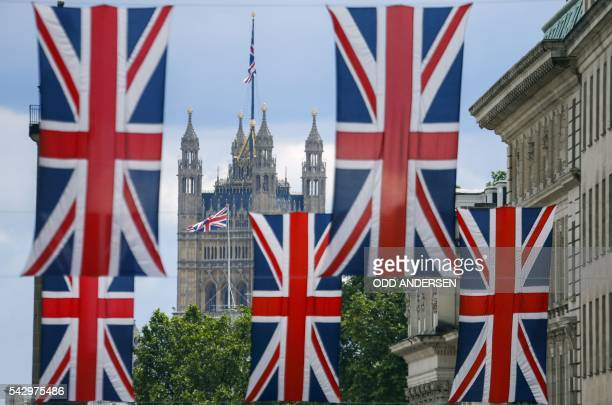 Union flag banners hang across a street near the Houses of Parliament in central London on June 25 after the announcement that the UK had voted on...