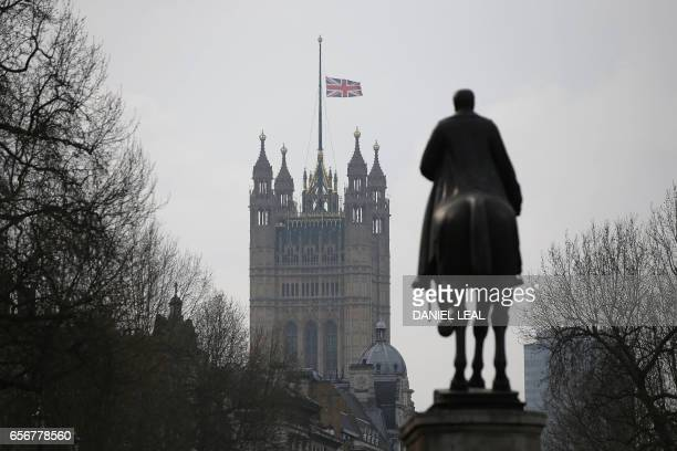 Union flag flies at half mast from the Houses of Parliament on March 23 2017 Seven people have been arrested including in London and Birmingham over...