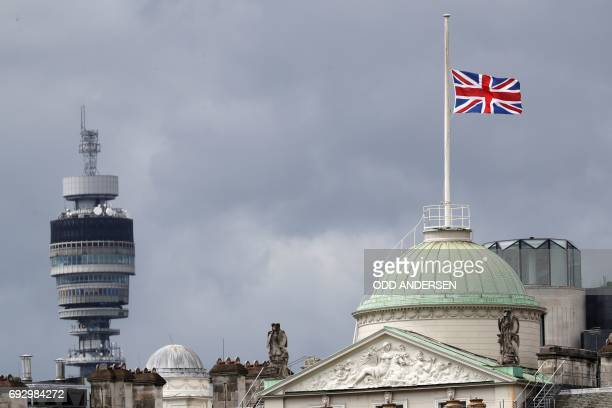 A Union flag flies at halfmast over Summerset House in commemoration to the victims of the June 3 London terror attack as the BT Tower is seen in the...