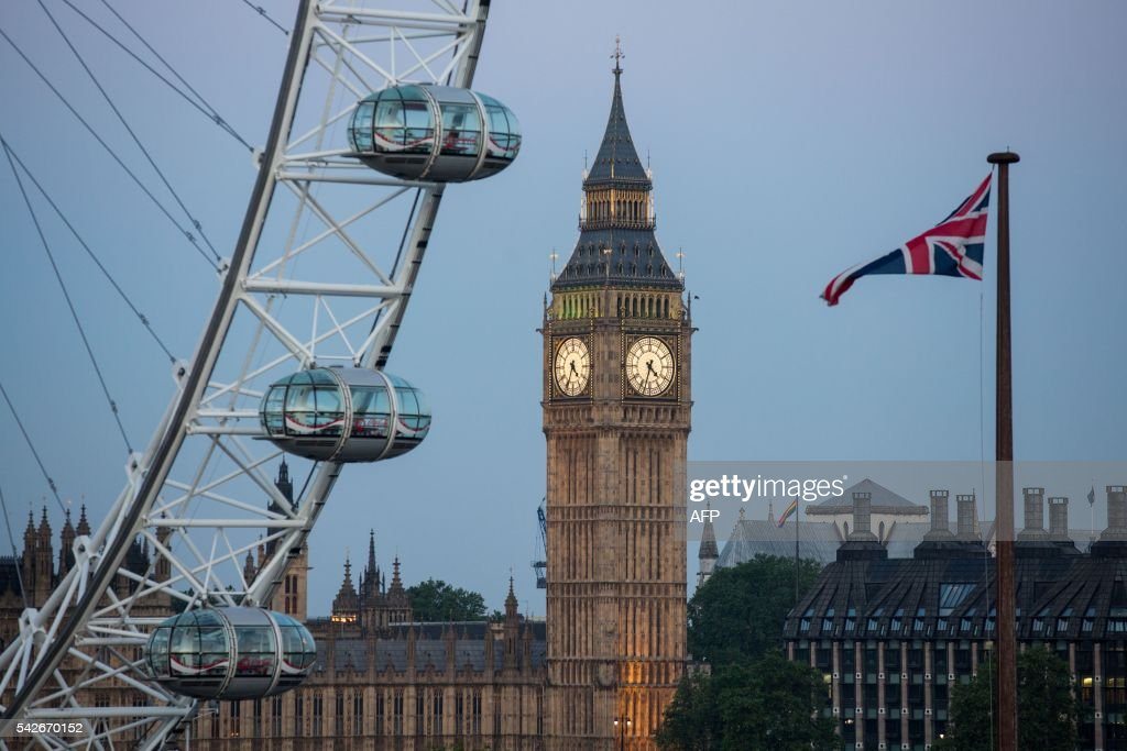 A Union flag flies beside the London Eye in front of the Queen Elizabeth Tower (Big Ben) and The Houses of Parliament in London on June 24, 2016. Britain's economy was plunged into a dizzying unknown on Friday as the country lurched towards the EU exit, with the world economy bracing for a hit on growth and unemployment. /