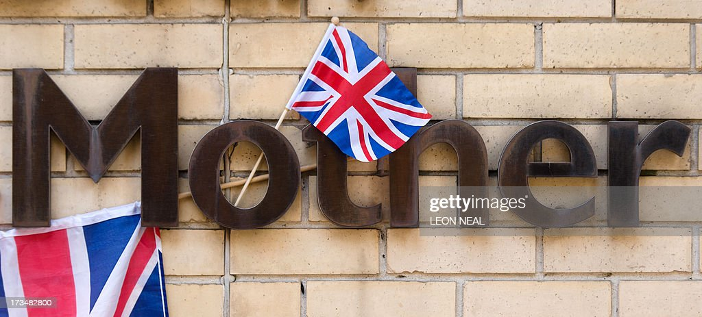 A Union Flag hangs from a sign near to the Lindo Wing of Saint Mary's Hospital in London, on July 15, 2013, where Prince William and his wife Catherine's baby will be born. The hospital is ready, the Wikipedia page and Twitter accounts are up and Britain's famously creative press are running out of ideas. But Mondat arrived with no sign of the royal baby. AFP PHOTO / LEON NEAL