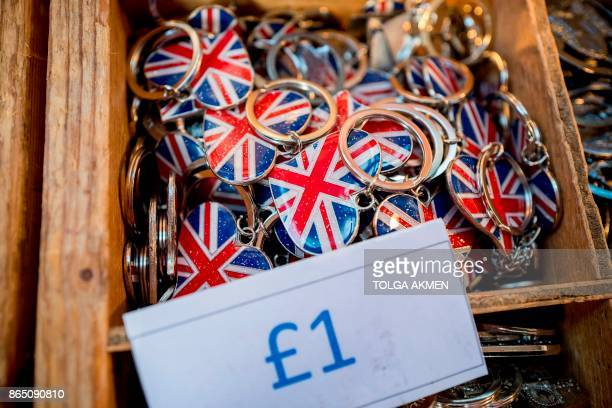 Union flag keyrings are pictured on display in Covent Garden in London on October 22 2017 Britain could be left 'poorer and weaker' by Brexit and...