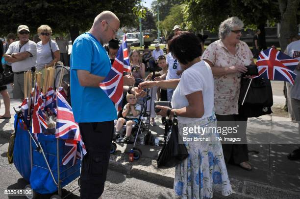 A Union Flag seller trades on the streets of Plymouth as hundreds of people cheer a homecoming parade of Royal Marines as they march to thank the...