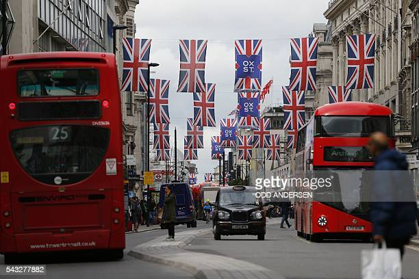 Union flags are attached between buildings along Oxford street in central london on June 27 2016 Shares in banks airlines and property companies...