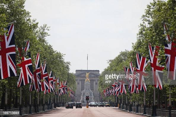 Union flags line The Mall leading to Buckingham Palace in central London on May 31 2013 Queen Elizabeth II marks the 60th anniversary of her...