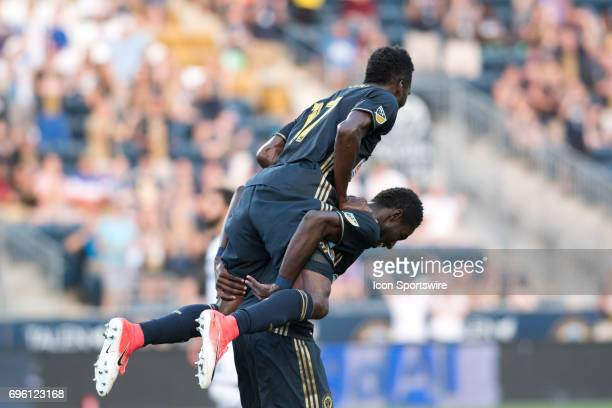 Union Forward CJ Sapong leaps onto Union Midfielder Derrick Jones after a goal in the first half during the US Open Cup Game between the Harrisburg...