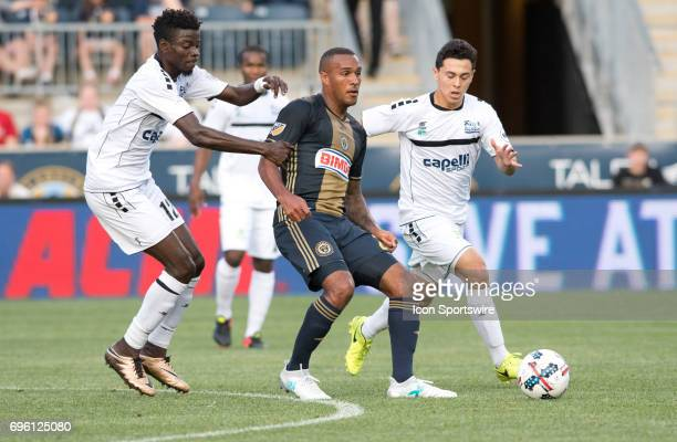 Union Forward Jay Simpson passes the ball under pressure in the first half during the US Open Cup Game between the Harrisburg City Islanders and the...