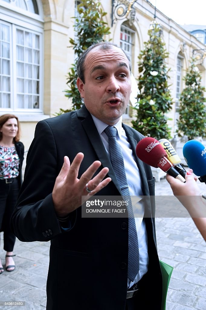 CFTC union general secretary Laurent Berger talks to the press after a meeting on the Socialist government's labour reforms with French Prime minister and French Labour minister, at the Hotel Matignon in Paris on June 29, 2016. / AFP / DOMINIQUE