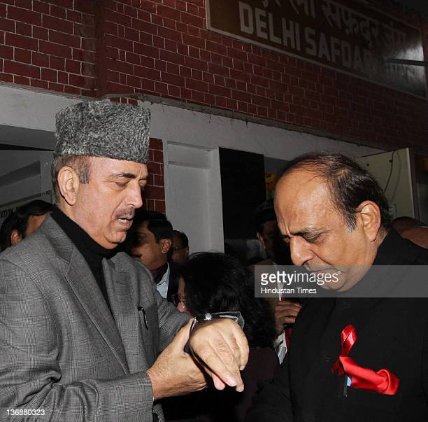 Union Health Minister Ghulam Nabi Azad and Union Railway Minister Dinesh Trivedi attend the flag off ceremony of the Red Ribbon Express train at...