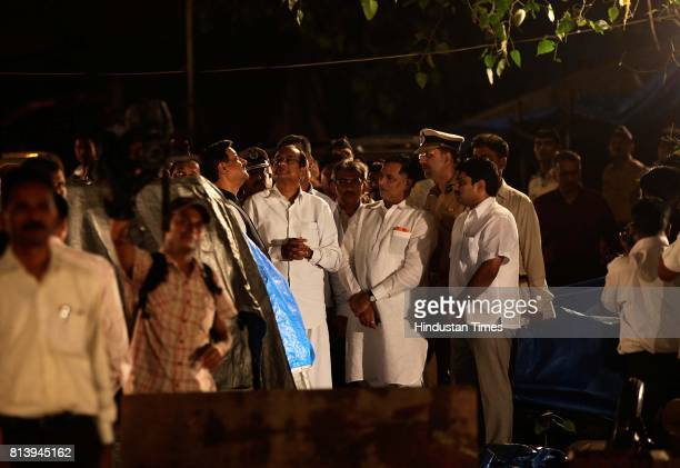 Union Home Minister P Chidambaram and Maharashtra Chief Minister Prithviraj Chavan at the blast site at Opera house in Central Mumbai India Thursday...