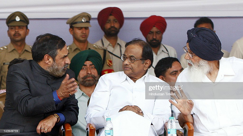 Union Home Minister P Chidambaram (C), Union Minister for Commerce Anand Sharma (L) and Punjab (India) Chief Minister Parkash Singh Badal (R) talk during the inauguration ceremony of the Integrated Check Post at Attari Border on April 13, 2012 in Amritsar, India. Developed over the area of 120 acres at the cost of 150 crores the ICP will facilitate the smoother and faster traffic movement, hence allowing more trucks to cross the borders. Home Minister P Chidambram will inaugurate the facility on April 13, 2012.
