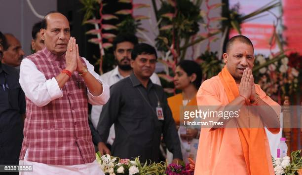 Union Home Minister Rajnath Singh and UP Chief Minister Yogi Adityanath at loan waiver certificate distribution event on August 17 2017 in Lucknow...