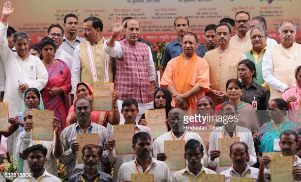 Union Home Minister Rajnath Singh and UP Chief Minister Yogi Adityanath distribute loan waiver certificate to the farmers on August 17 2017 in...