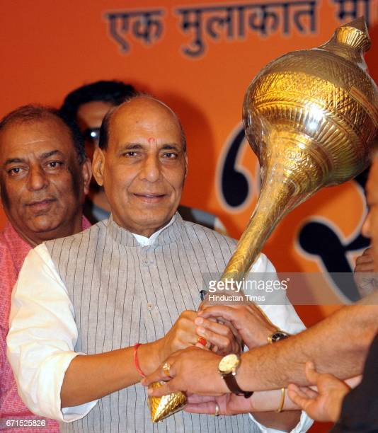 Union Home Minister Rajnath Singh holds mace in his hand at a meeting of Trader's Association on April 22 2017 in Lucknow India After the meeting...