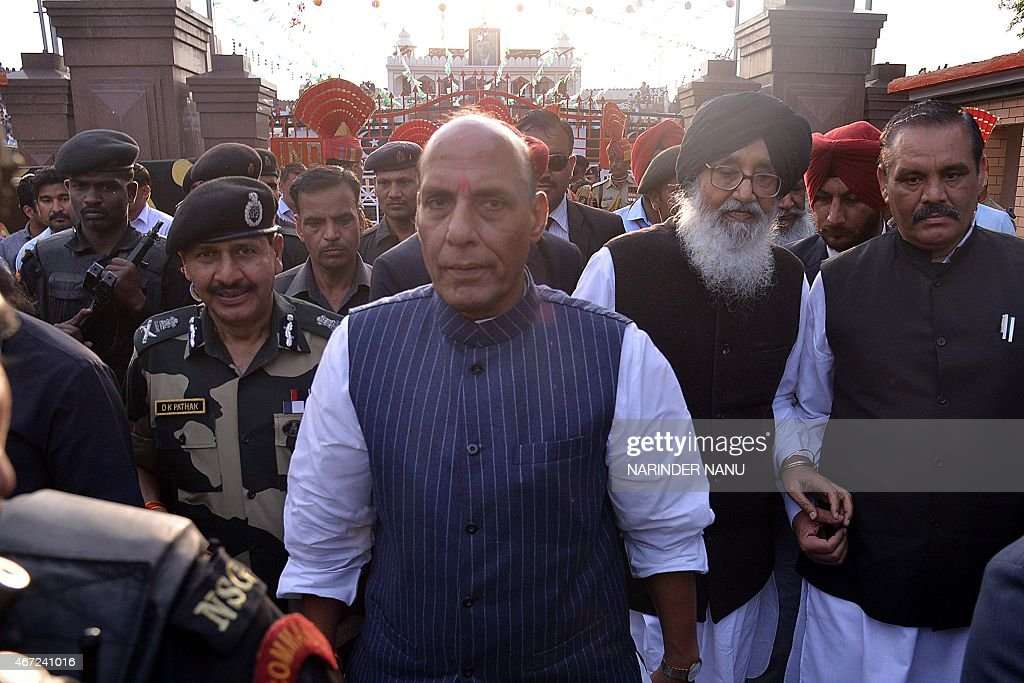 Union Home Minister <a gi-track='captionPersonalityLinkClicked' href=/galleries/search?phrase=Rajnath+Singh&family=editorial&specificpeople=582959 ng-click='$event.stopPropagation()'>Rajnath Singh</a> (C), Punjab state chief minister <a gi-track='captionPersonalityLinkClicked' href=/galleries/search?phrase=Parkash+Singh+Badal&family=editorial&specificpeople=3634862 ng-click='$event.stopPropagation()'>Parkash Singh Badal</a> (2R) and Border Security Force (BSF) Director General DK Pathak (L) walk during the closing ceremony for the Camel Safari expedition in Amritsar on March 22, 2015. In a joint venture by the BSF and Tata Steel Adventure Foundation (TSAF), 20 women are participating in the expedition which is a part of the BSF's Golden Jubilee celebrations. The expedition started from Bhuj in the state of Gujarat and will culminate at India-Pakistan Wagah border post on March 22, after travelling some 2300 kms.