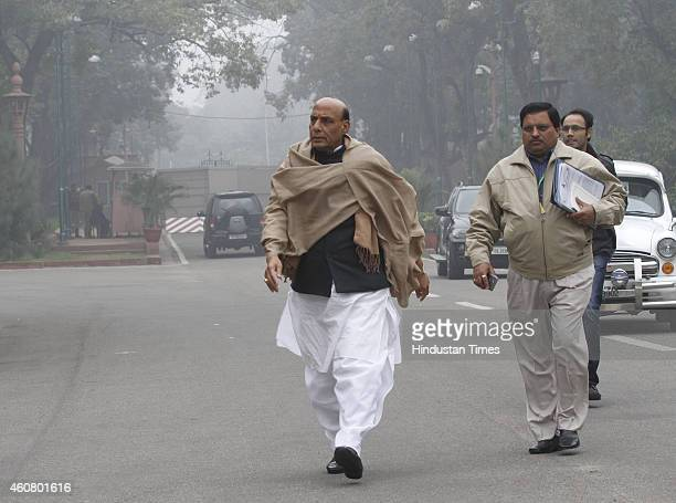 Union Home Minister Rajnath Singh surrounded by media persons at Parliament House on last day of Parliament Winter Session on December 23 2014 in New...