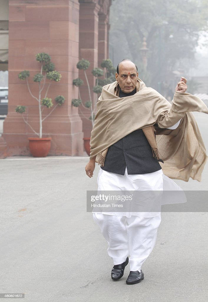 Union Home Minister <a gi-track='captionPersonalityLinkClicked' href=/galleries/search?phrase=Rajnath+Singh&family=editorial&specificpeople=582959 ng-click='$event.stopPropagation()'>Rajnath Singh</a> surrounded by media persons at Parliament House on last day of Parliament Winter Session on December 23, 2014 in New Delhi, India. The performance of the two houses stood in stark contrast as the month-long winter session of parliament concluded today with the Lok Sabha having passed a record 18 bills while the Rajya Sabha lost a majority of its working days to disruption.