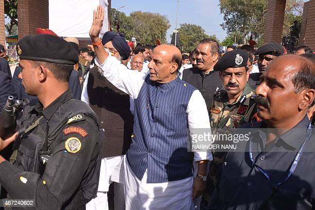 Union Home Minister Rajnath Singh waves during a closing ceremony for the Camel Safari expedition in Amritsar on March 22 2015 In a joint venture by...
