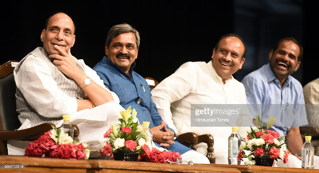 Union Home Minister Rajnath Singh with Delhi BJP President Satish Upadhyay, and other BJP Leaders attending the Vikas Parv Function to celebrate the completion of second successful year of the Central Government headed by Prime Minister Narendra Modi at Siri Fort Auditorium on May 27, 2016 in New Delhi, India.
