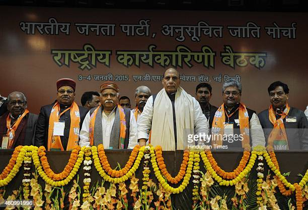 Union Home Minister Rajnath Singh with leaders during the BJP Scheduled Caste Front National Executive meeting on January 3 2015 in New Delhi India...