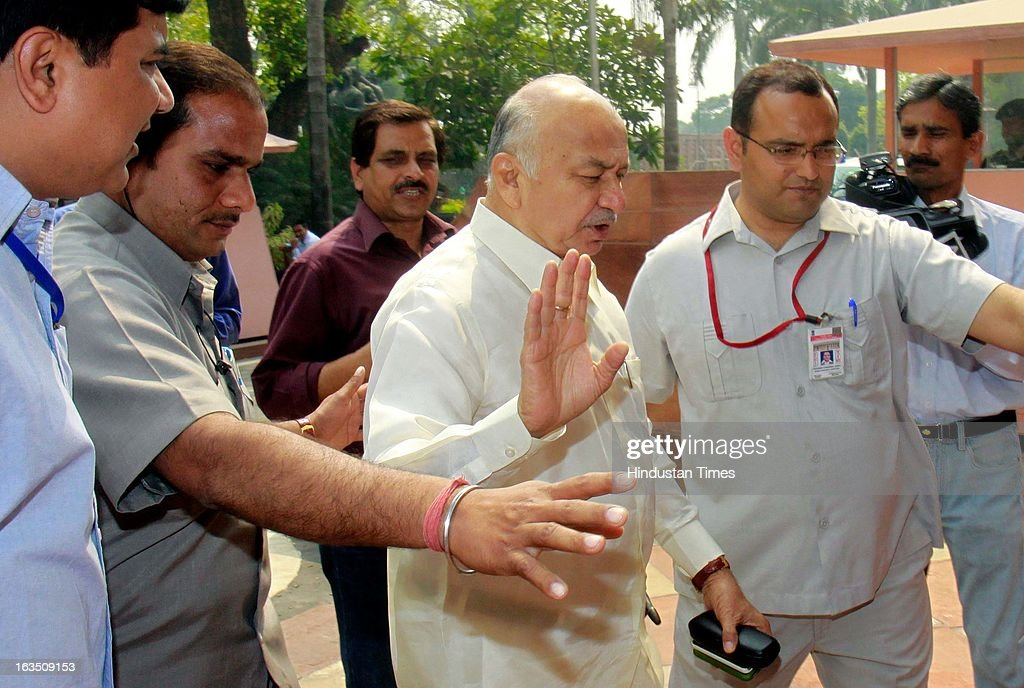 Union Home Minister Sushil Kumar Shinde arrive at parliament house during the ongoing parliament budget session on March 11, 2013 in New Delhi, India.