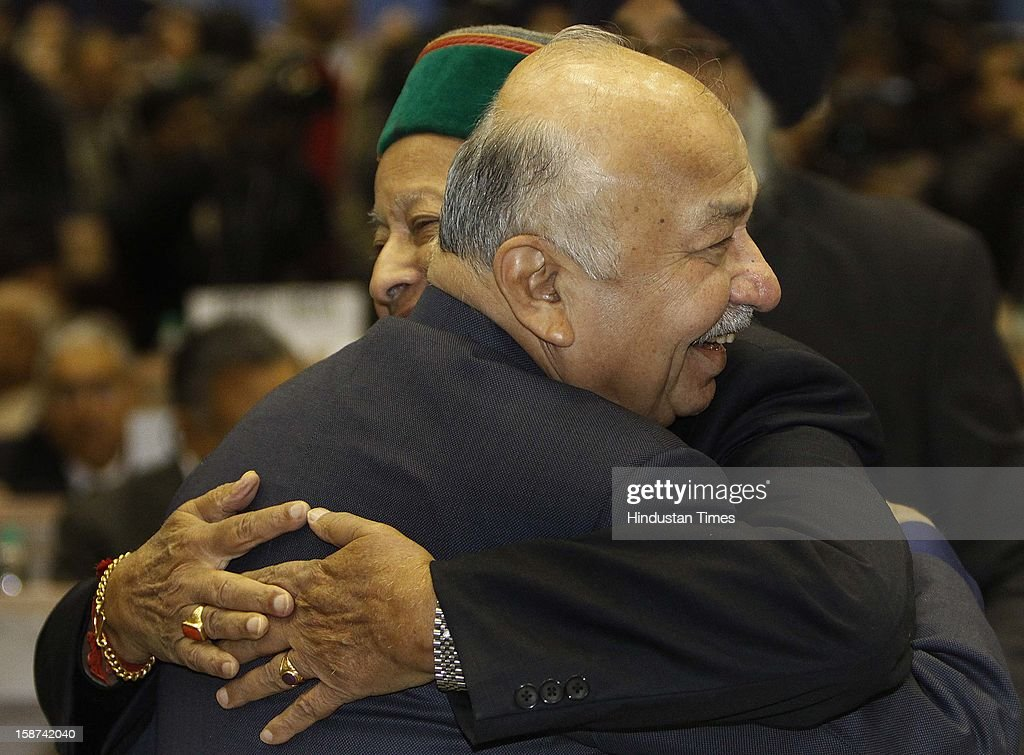 Union Home Minister Sushil Kumar Shinde hugs Himachal Pradesh Chief Minister Virbhadra Singh at the 57th National Development Council (NDC) meeting on December 27, 2012 in New Delhi, India.