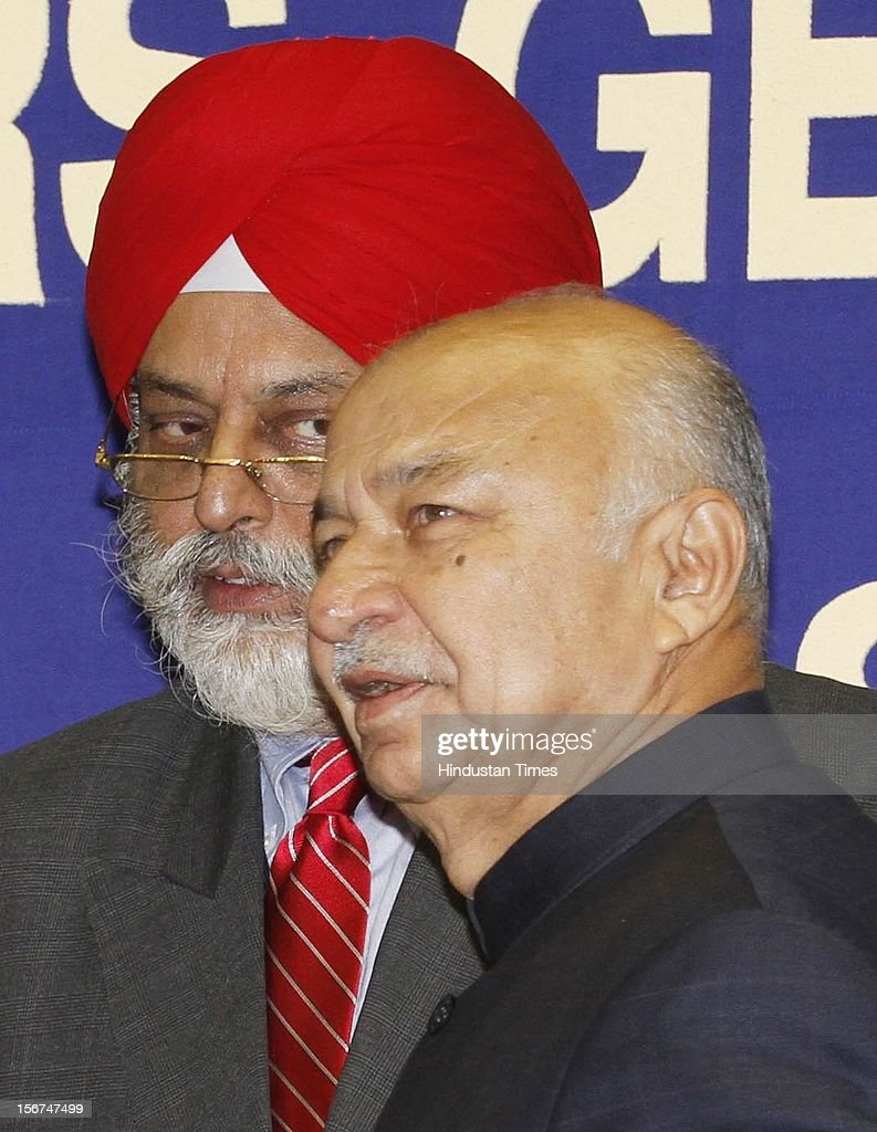 'NEW DELHI, INDIA- SEPTEMBER 6: Union Home Minister Sushil Kumar Shinde with IB chief Nehchal Sandhu at the All India Conference of DGPs / IGPs at Vigyan Bhavan on September 6, 2012 in New Delhi, India. (Photo by Arvind Yadav/Hindustan Times via Getty Images) '
