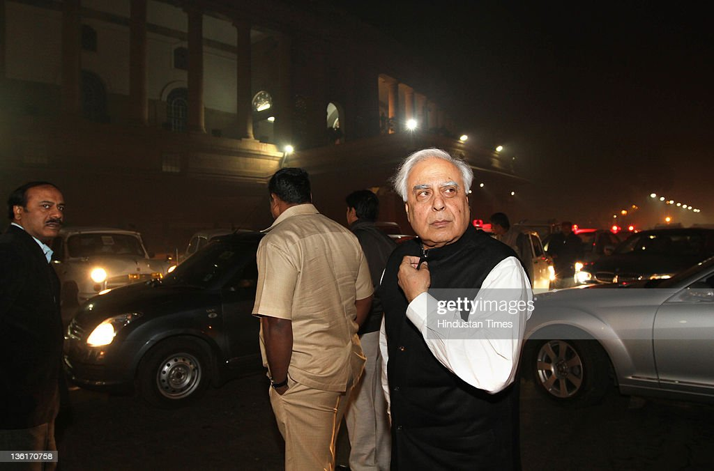 Union HRD minister Kapil Sibal comes out after the voting on Lokpal Bill in Lok Sabha at Parliament house on December 27, 2011 in New Delhi, India. The Lokpal bill was passed by voice vote with 10 amendments, however the Left parties, SP and BSP walked out in protest before the voting.