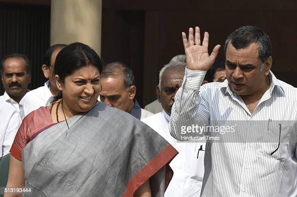 Union HRD Minister Smriti Iranai with Paresh Rawal after NDA leaders meeting at Parliament House on March 1 2016 in New Delhi India Both the Houses...
