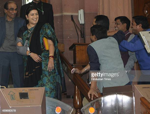 Union HRD Minister Smriti Irani sharing some light moments with reporters at Parliament House during the winter session on November 28 2014 in New...