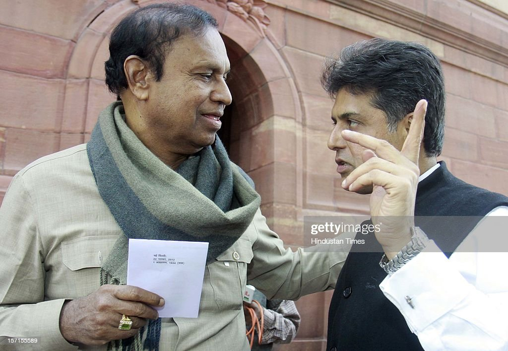 Union Information and Broadcasting minister Manish Tiwari (L) talking with DMK Leader TR Balu at Parliament House after attending Parliament Winter Session on November 29, 2012 in New Delhi, India. The logjam in Parliament finally ended after government agreed to the voting on FDI issue. The voting after debate will be held next week on December 4 and 5.