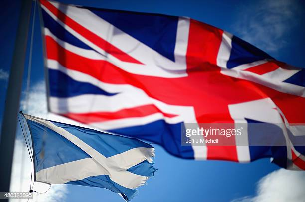 Union Jack and Saltire flags blow in the wind near to Glen Coe on March 24 2014 in Glen Coe Scotland A referendum on whether Scotland should be an...