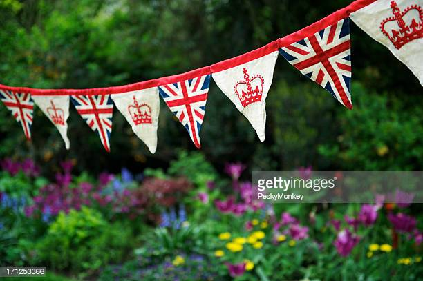 Union Jack British Flag Bunting Hangs Across English Garden