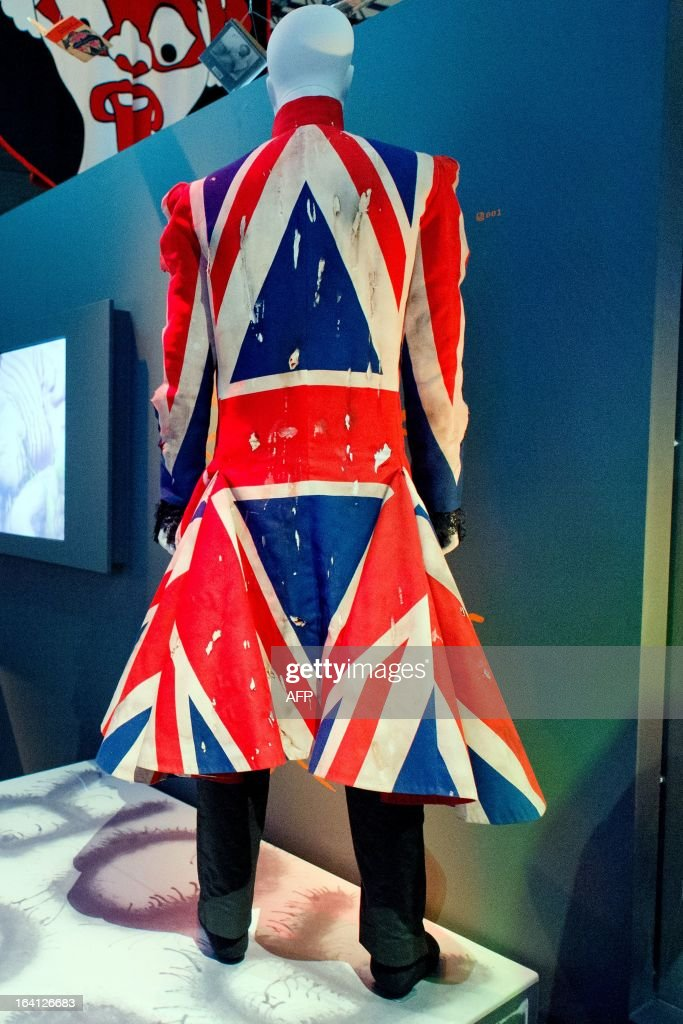 A Union Jack coat designed by Alexander McQueen and worn by musician David Bowie is displayed at the 'David Bowie is' exhibition at the Victoria and Albert (V&A) museum in central London on March 20, 2013. Running March 23 to August 11, the exhibition features more than 300 objects that include handwritten lyrics, original costumes, fashion, photography, film, music videos, set designs and Bowie's own instruments. AFP PHOTO/Leon Neal