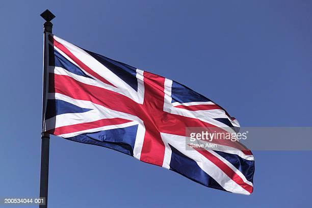 UK, Union Jack flag, against blue sky