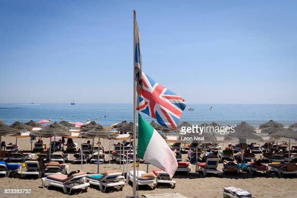 Union Jack Flag flies above sunbathers on July 24 2017 in Benalmadena Spain With Brexit discussions yet to provide answers to a number of questions...