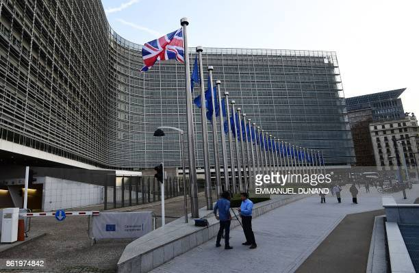 A Union Jack flag flies in front of the European Commission building as British Prime Minister May is due to meet European Commission President...
