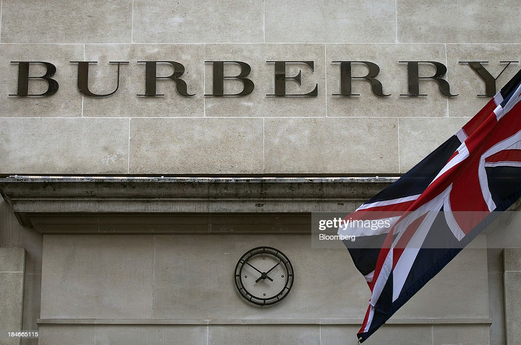 A Union Jack flag flies outside Burberry Group Plc's store on New Bond Street in London, U.K., on Wednesday, Nov. 7, 2012. Burberry Group said Christopher Bailey will become chief executive officer of the largest British luxury-goods producer, as CEO Angela Ahrendts departs the company to work at Apple Inc. Photographer: Simon Dawson/Bloomberg via Getty Images
